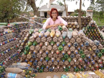 Recycling plastic bottles to build houses - Building a house with plastic bottles ...